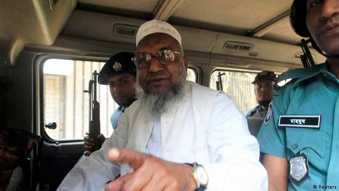 Bangladesh's Jamaat-e-Islami leader Abdul Quader Mollah gestures as he talks from a police van after a war crimes tribunal sentenced him to life imprisonment in Dhaka, in this February 5, 2013 file photo. Bangladesh's Supreme Court on September 17 sentenced the top Islamic leader to death for war crimes during the country's 1971 independence war, rejecting an earlier life sentence imposed by a war crimes tribunal. The tribunal found Mollah, assistant secretary general of the Jamaat-e-Islami party, guilty of murder, rape and torture on Feb. 5. REUTERS/Stringer/Files (BANGLADESH - Tags: POLITICS RELIGION CRIME LAW)