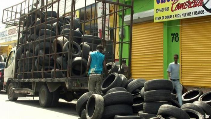 A man with a pile of car tires in the Dominican Republic