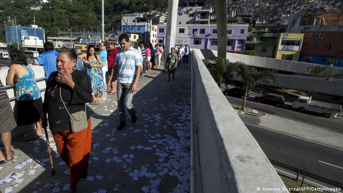 People queue before the opening of the polling stations, in Rio de Janeiro's Rocinha shantytown. (Photo ANTONIO SCORZA/AFP/GettyImages)