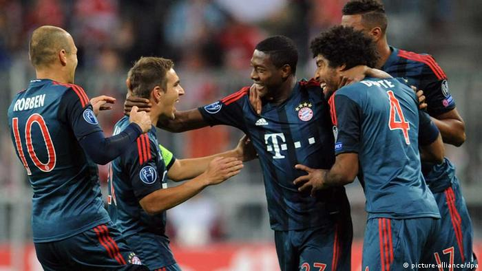 Munich's David Alaba (C) celebrates with Arjen Robben (L-R), Philipp Lahm and Dante after scoring the 1-0 during the UEFA Champions League Group D soccer match between FC Bayern Munich and CSKA Moscow at München Arena in Munich, Germany, 17 September 2013. Photo: Andreas Gebert/dpa