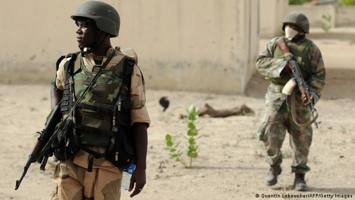 Nigerian soldiers patrol in the north of Borno state close to a former camp of Islamist extremist group Boko Haram in July. Photo: Quentin Leboucher/AFP/Getty Images