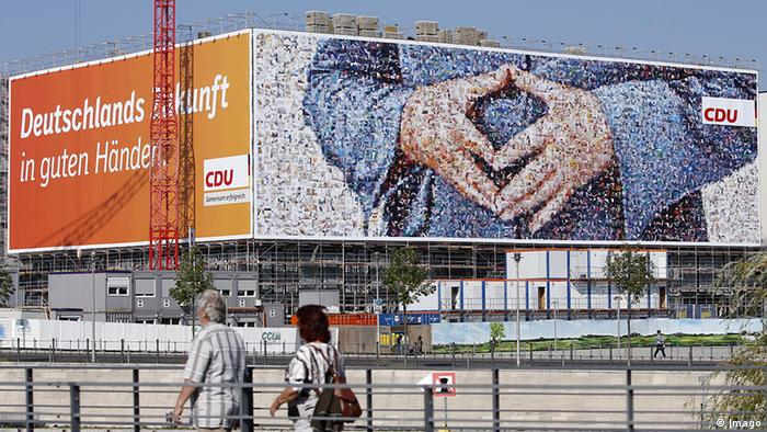 Large-size billboard the CDU at Berlin Central Station under the Motto Germany in Good Hands advertises the CDU with a Large-size billboard on the the typical Hand position from Chancellor Angela Merkel to see is for the Federal election 2013 (Photo: imago/Reiner Zensen