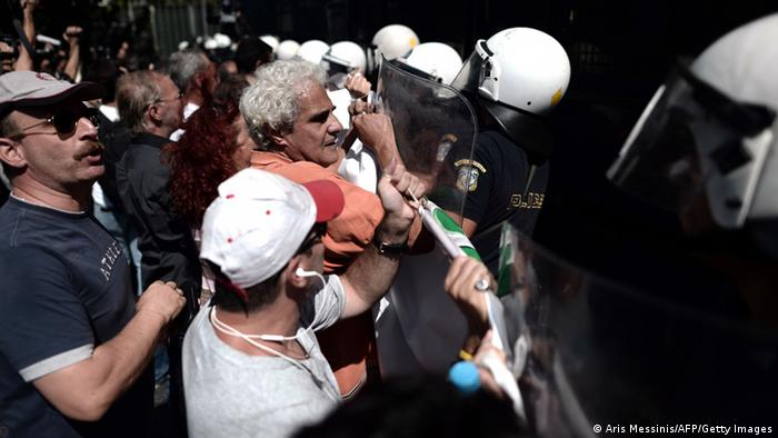 School teachers are blocked by riot police during a demonstration in central Athens ARIS MESSINIS/AFP/Getty Images