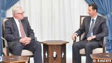 Russlands Vizeaußenminister Sergej Rjabkow (links) und Syriens Machthaber Baschar al-Assad bei einem Treffen 2013