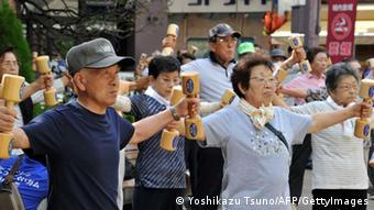 Elderly people work out with wooden dumb-bells in the grounds of a temple in Tokyo on September 17, 2012 to celebrate Japan's Respect-for-the-Aged-Day. (Photo: YOSHIKAZU TSUNO/AFP/GettyImages)