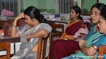 School teachers confined in the staff room while it's rampage outside!. Foto: Nurunnahar Sattar, September 2013, Indien