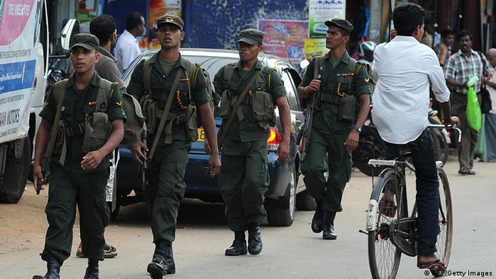 Sri Lankan army troopers patrol in Jaffna, 400 kilometres (250 miles) north of the capital Colombo on September 18, 2013. Sri Lanka is holding the first ever provincial council election, scheduled for September 21. (Photo: AFP)