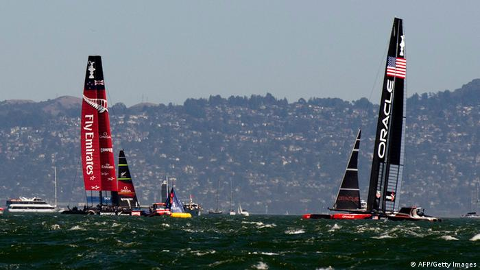 Emirates Team New Zealand (L) and Oracle Team USA sail past one another during pre-race manuevers during the 34th America's Cup September 17, 2013 in San Francisco. Racing for the day was called off due to high winds. Photo:DON EMMERT/AFP/Getty Images
