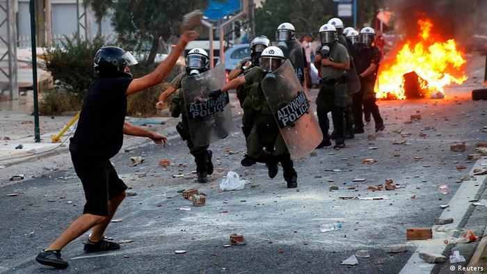 Tensions Mount In Greece As Right Wing Extremists Suspected of Killing A Left Wing Musician A protester hurls a rock at police during clashes between police and angry anti-fascist protesters following the killing of a 35-year-old anti-racism rapper by a man who sympathized with the far-right Golden Dawn group in an Athens suburb September 18, 2013. More than 5,000 people rallied where the man was stabbed and marched through the streets of Keratsini. Police fired teargas at protesters who broke off the march hurling stones and petrol bombs at a police station and set garbage containers on fire. REUTERS/Yannis Behrakis (GREECE - Tags: CIVIL UNREST POLITICS)