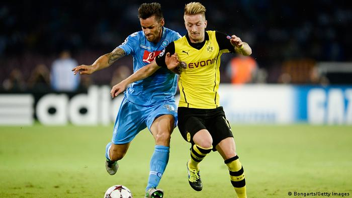 NAPLES, ITALY - SEPTEMBER 18: Gonzalo Higuain of SSC Napoli and Marco Reus of Borussia Dortmund battle for the ball during the UEFA Champions League Group F match between SSC Napoli and Borussia Dortmund at Stadio San Paolo on September 18, 2013 in Naples, Italy. (Photo by Dennis Grombkowski/Bongarts/Getty Images)