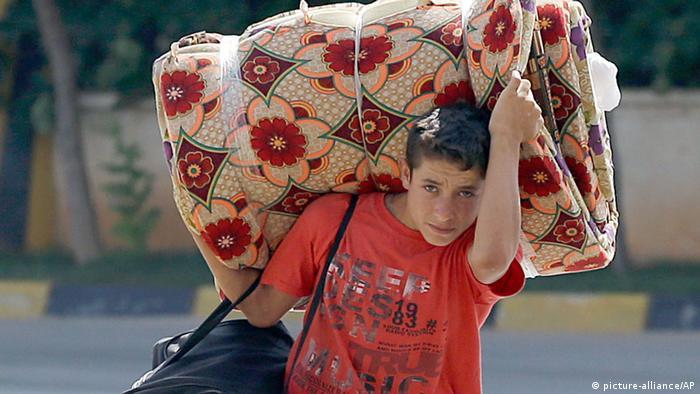 Ein syrischer Flüchtlingsjunge (Foto: AP)