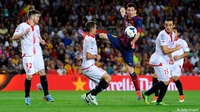 BARCELONA, SPAIN - SEPTEMBER 14: Lionel Messi of FC Barcelona shoots towards goal among Sevilla FC players during the La Liga match between FC Barcelona and Sevilla FC at Camp Nou on September 14, 2013 in Barcelona, Spain. (Photo by David Ramos/Getty Images)