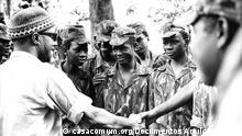 1. Titel: Amílcar Cabral 2. Bildbeschreibung: Amilcar Cabral, Generalsekretär der PAIGC, mit einer Gruppe von jungen Kämpfern. 3. Wann wurde das Bild gemacht: 1972 4. Wo wurde das Bild aufgenommen: Guinea-Bissau 5. Schlagwörte: PAIGC, Guinea-Bissau, Amílcar Cabral, Unabhängigkeit, Kolonien, Estado Novo, Portugiesische Kolonialreich, Unabhängigkeit, Entkolonialisierung, Nelkenrevolution, 40 Jahre Nelkenrevolution – 40 Jahre Unabhängigkeit 6. Archiv: casacomum.org/Documentos Amílcar Cabral