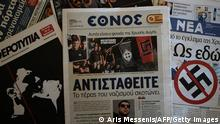 A front-page picture in centre-left daily Ethnos (C), shows the self-confessed killer at a Golden Dawn summer camp gathering on September 19, 2013. Musician Pavlos Fyssas was fatally stabbed in the working-class Athens district of Keratsini on September 18 by a 45-year-old truck driver who later allegedly confessed his Golden Dawn affiliation to police. The victim's family said that Fyssas and a small group of friends had been ambushed by a large gang of Golden Dawn supporters outside a cafeteria. The title of the paper reads 'The monster of Nazism kills -- resist'. AFP PHOTO / ARIS MESSINIS (Photo credit should read ARIS MESSINIS/AFP/Getty Images)