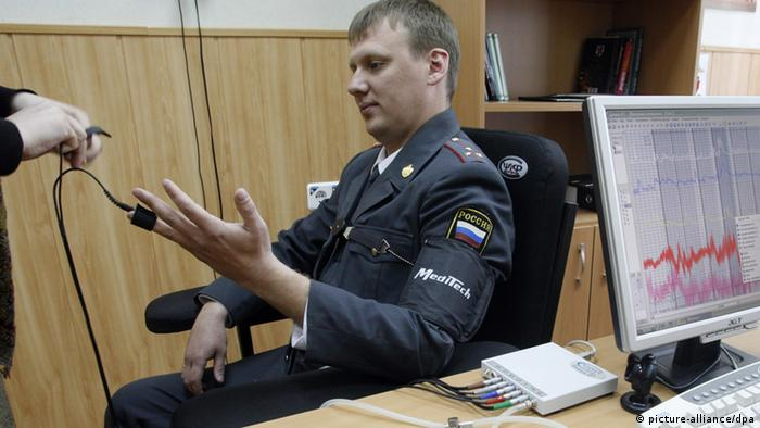 Police officer takes a lie detector test Photo ITAR-TASS / Valery Matytsin, dpa - Report