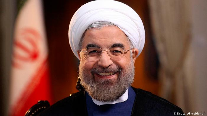 Iranian President Hassan Rouhani smiles during an interview with Ann Curry from the U.S. television network NBC in Tehran, in this picture taken September 18, 2013, and provided by the Iranian Presidency. Rouhani said in the television interview with NBC News on Wednesday that his government would never develop nuclear weapons and that he had complete authority to negotiate a nuclear deal with the West. Reuters/President.ir/Handout via Reuters (IRAN - Tags: POLITICS HEADSHOT) ATTENTION EDITORS � THIS IMAGE WAS PROVIDED BY A THIRD PARTY. NO SALES. NO ARCHIVES. FOR EDITORIAL USE ONLY. NOT FOR SALE FOR MARKETING OR ADVERTISING CAMPAIGNS. THIS PICTURE IS DISTRIBUTED EXACTLY AS RECEIVED BY REUTERS, AS A SERVICE TO CLIENTS