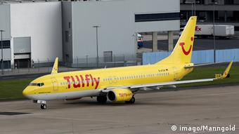 A yellow TUIfly plane on a runway Copyright: imago/Manngold