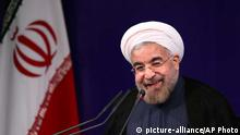 Iran's new President Hasan Rouhani smiles during his first press conference since taking office at the presidency compound in Tehran, Iran, Tuesday, Aug. 6, 2013. Rouhani says his country is ready for serious and swift talks with world powers over the nation's controversial nuclear program. (AP Photo/Ebrahim Noroozi)
