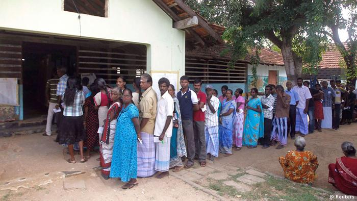 Ethnic Tamils wait in line to cast their votes at a polling station during the first provincial polls in 25 years in Jaffna, a former war zone in northern Sri Lanka about 400 kilometres (249 miles) north of Colombo, September 21, 2013. . REUTERS/Dinuka Liyanawatte