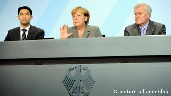 Chancellor Merkel, center, CSU chair Horst Seehofer, right, and FDP chair Philipp Rösler sitting at a press conference Photo: Maurizio Gambarini dpa