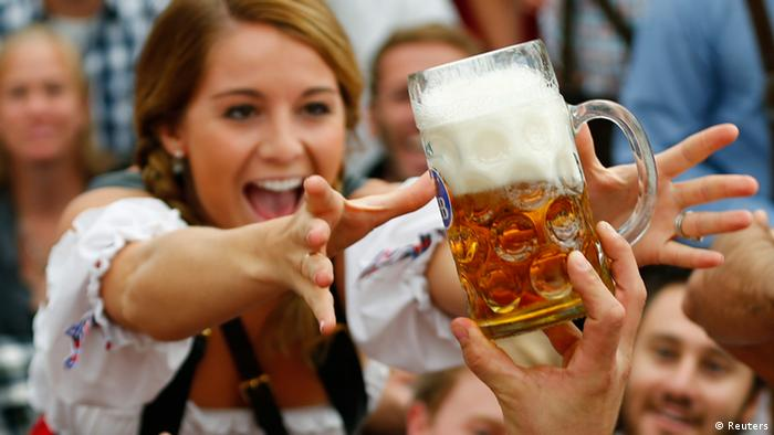 A visitor reaches for of the one of the first mugs of beer after the tapping of the first barrel during the opening ceremony for the 180th Oktoberfest at the Hofbraeu tent in Munich September 21, 2013. Millions of beer drinkers from around the world will come to the Bavarian capital over the next two weeks for the 180th Oktoberfest, which starts today and runs until October 6. REUTERS/Michael Dalder (GERMANY - Tags: ENTERTAINMENT SOCIETY TPX IMAGES OF THE DAY)