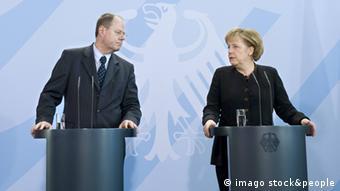 German finance minister Peer Steinbrück SPD and Chancellor Angela Merkel CDU right in 2009