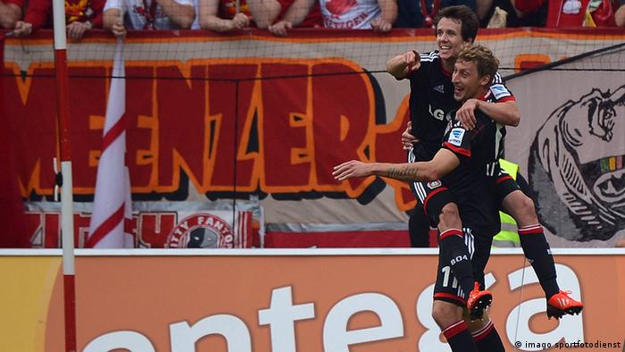 Robbie Kruse and Stefan Kiessling celebrate the former's first goal in Saturday's 4-1 win over Mainz. Photo: dpa