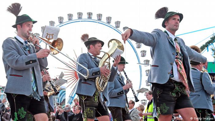 A brass band plays in front of the ferris wheel at 2013 Oktoberfest (Getty Images)