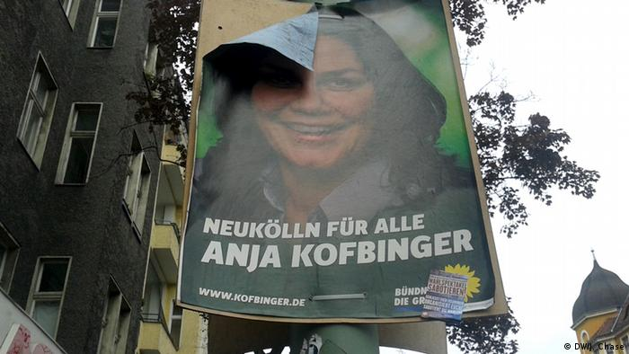 A 2013 campaign poster for Anja Kofbinger in Berlin slowly peels off its cardboard backing
