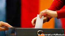 A voter casts his ballot at the polling station where German Chancellor and Christian Democratic Union (CDU) leader Angela Merkel is expected to cast her vote for the German general election (Bundestagswahl), in Berlin September 22, 2013. REUTERS/Kai Pfaffenbach (GERMANY - Tags: POLITICS ELECTIONS)