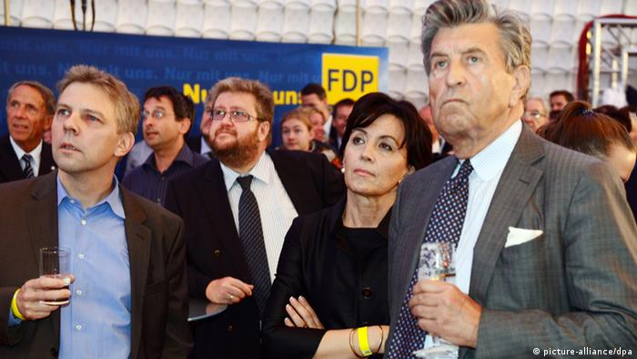 FDP members looking miserable as the results come in Photo: Maurizio Gambarini/dpa +++(c) dpa - Bildfunk+++