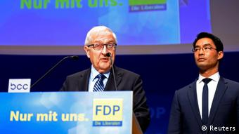 Free Democratic Party (FDP) top candidate Rainer Bruederle (L) and German Economy Minister and leader of the liberal FDP Philipp Roesler (R) address to members after first exit polls in the German general election (Bundestagswahl) in Berlin September 22, 2013. REUTERS/Fabian Bimmer (GERMANY - Tags: POLITICS ELECTIONS)