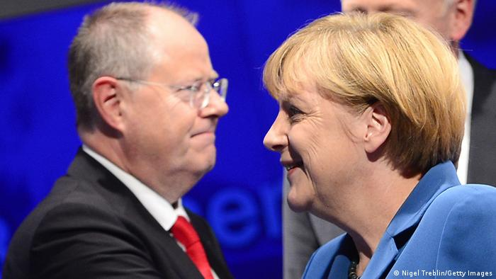 BERLIN, GERMANY - SEPTEMBER 22: Angela Merkel, German Chancellor and Chairwoman of the German Christian Democrats (CDU) and Peer Steinbrueck, chancellor candidate of the German Social Democrats (SPD) are seen at the end to the 'Elefantenrunde' live television broadcast at ZDF studios following federal elections on September 22, 2013 in Berlin, Germany. Today Germany is holding federal elections that will determine whether the current Chancellor Angela Merkel of the German Christian Democrats (CDU) will be voted in for a third term. (Photo by Nigel Treblin/Getty Images)