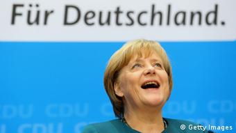 BERLIN, GERMANY - SEPTEMBER 23: Angela Merkel, German Chancellor and Chairwoman of the German Christian Democrats (CDU), looks on during a press conference after a meeting of the CDU governing board on the first day after German federal elections at CDU headquarter Konrad-Adenauer-Haus on September 23, 2013 in Berlin, Germany. The CDU finished with approximately 42% of the vote, which puts the party just shy of a majority of seats in the Bundestag. The CDU will now face the task of finding a coalition partner, which is complicated by the failure of its current partner, the German Free Democrats (FDP), to stay above the 5% necessary to retain its Bundestag seats. (Photo by Alexander Hassenstein/Getty Images)