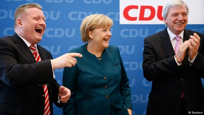 German Chancellor and leader of the Christian Democratic Union ( CDU) Angela Merkel, Hesse's Prime Minister Volker Bouffier (R) and CDU party secretary general Hermann Groehe (L) laugh before a CDU party board meeting in Berlin September 23, 2013, the day after the German general election. German Chancellor Angela Merkel faces the daunting prospect of persuading her centre-left rivals to keep her in power after her conservatives notched up their best election result in more than two decades but fell short of an absolute majority. REUTERS/Fabrizio Bensch (GERMANY - Tags: POLITICS ELECTIONS)