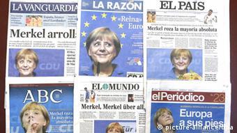 Titelseiten ausländischer Zeitungen mit Merkel-Artikeln Foto: