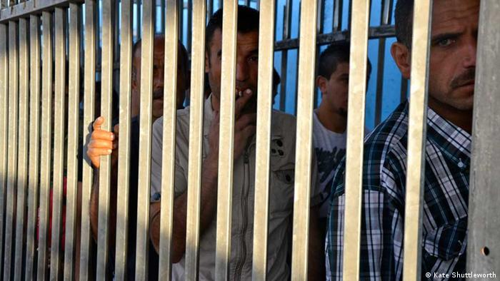 Palestinian men queuing to enter Jerusalem at the Bethlehem checkpoint