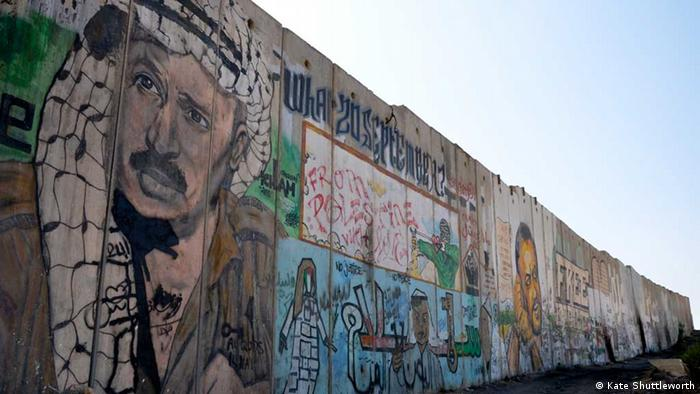 A portrait of Yasser Arafat is painted on the separation wall at Qalandiya checkpoint in the West Bank