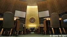 NEW YORK - MAY 12: The United Nations logo on the back wall of the General Assembly Hall of the United Nations is seen from the floor May 12, 2006 at the United Nations headquarters in New York. NEW YORK - MAY 12: The view from the speakers rostrum in the General Assembly Hall of the United Nations is seen May 12, 2006 at the United Nations headquarters in New York. The General Assembly Hall was remodeled in 1979 to accommodate up to 182 delegations, each of which has six seats. All seats are equipped with earphones, broadcasting simultaneously in the Assembly's six official languages: Arabic, Chinese, English, French, Russian and Spanish. The United Nations headquarters, completed in 1952, is widely considered to be a landmark achievement of the International Style of architecture. (Photo by Chris Hondros/Getty Images)