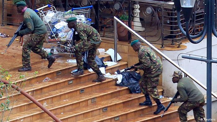 Kenya Defence Forces soldiers take their position at the Westgate shopping centre, on the fourth day since militants stormed into the mall, in Nairobi September 24, 2013. Somalia's al Shabaab Islamist group said on Tuesday there were countless dead bodies in the Westgate shopping centre as security forces searched for militants still holed up in the complex after a weekend attack that authorities say killed 62 people. REUTERS/Noor Khamis (KENYA - Tags: CIVIL UNREST CRIME LAW MILITARY)