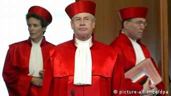 Three German Federal Court judges standing side by side