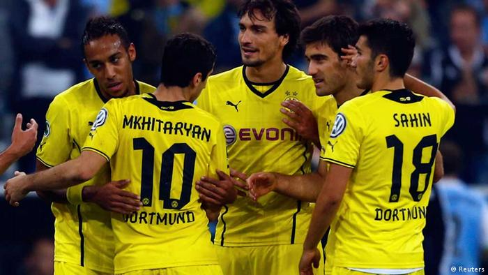 Borussia Dortmund players celebrate after their second round German Cup victory over 1860 Munich on Tuesday. Photo: Reuters