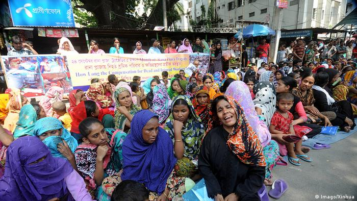 Bangladesh textile workers wait in the street