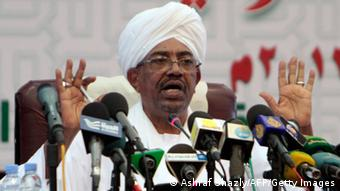 GettyImages181646045 Sudanese President Omar al-Bashir speaks during a press conference in Khartoum late on September 22, 2013. The United States was stuck on the horns of a dilemma, mulling whether to grant a visa to the Sudanese president, an indicted war crimes suspect, amid growing pressure to bar him from a UN summit. Bashir's request for a visa to travel to New York for next week's UN General Assembly has embarrassed the US government and the United Nations. AFP PHOTO / ASHRAF SHAZLY (Photo credit should read ASHRAF SHAZLY/AFP/Getty Images)