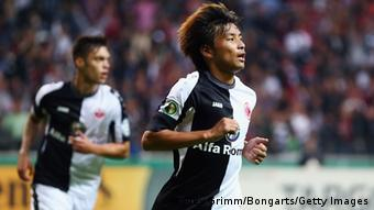 GettyImages 181793215 FRANKFURT AM MAIN, GERMANY - SEPTEMBER 25: Takashi Inui of Frankfurt celebrates his team's first goal during the DFB Cup second round match between Eintracht Frankfurt and VfL Bochum at Commerzbank-Arena on September 25, 2013 in Frankfurt am Main, Germany. (Photo by Alex Grimm/Bongarts/Getty Images)