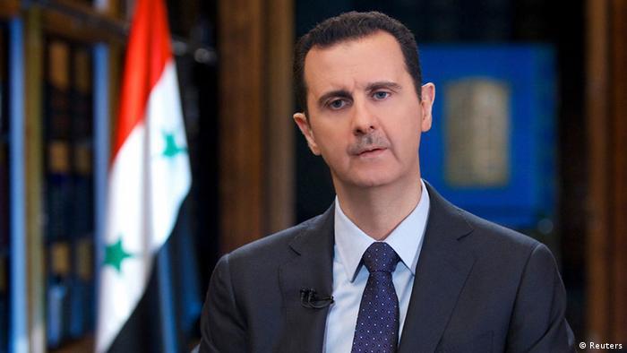 بشار الأسد في حوار مع قناة تلفزيونية من عام 2013.