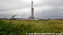 A drilling rig exploring for shale gas of oil company Chevron on June 11, 2013 in a village of Ksiezomierz in south-eastern Poland. The area where Chevron wants to drill is the cleanest and best-developed agricultural in Poland. Initial estimates suggest Poland has huge reserves of shale gas and authorities in Warsaw hope development of the sector could boost national energy security. AFP PHOTO / JANEK SKARZYNSKI (Photo credit should read JANEK SKARZYNSKI/AFP/Getty Images)