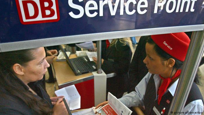 An employee assists a customer at the Deutsche Bahn service point in Cologne, Germany Photo: Fredrik von Erichsen dpa