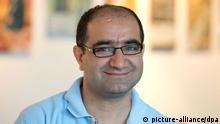 Der Kandidat für die Bundestagswahl von Bündnis 90/Die Grünen, Özcan Mutlu, aufgenommen am 15.07.2013 in Berlin. Foto: Soeren Stache/dpa