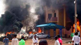 Cars burn in front of a building during protests over fuel subsidy cuts in Khartoum September 25, 2013. At least 27 people have been killed in protests in Khartoum over fuel subsidy cuts, a medical source said on Thursday as another bout of the worst unrest seen in Sudan's relatively well-off central regions for years broke out in its biggest port. Thousands had marched in Khartoum on Wednesday, torching cars, buildings and petrol stations. Picture taken September 25, 2013. REUTERS/Stringer (SUDAN - Tags: CIVIL UNREST POLITICS BUSINESS ENERGY)